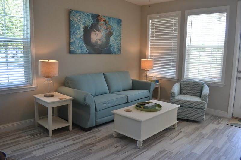 Living room with direct access to pool. Has brand new queen sleeper sofa bed