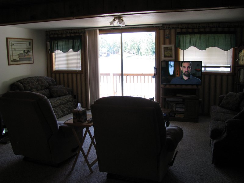 Living room has 2 couches, 2 recliners, TV has Directv service.