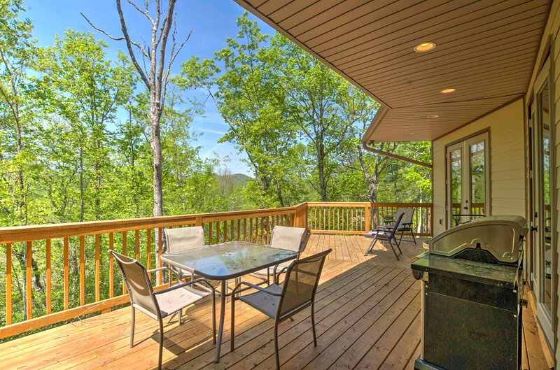 Enjoy the fresh mountain air and serene scenery from this second-story deck.