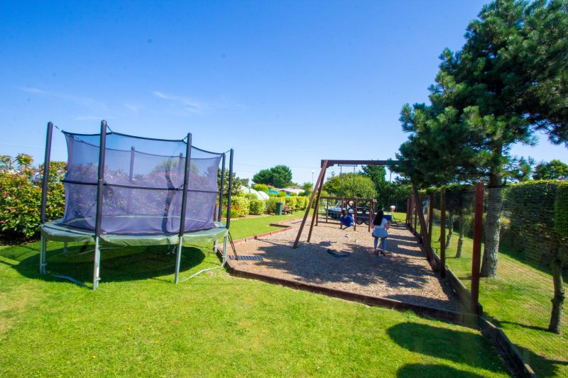 Play park on campsite available for cottages guests to use