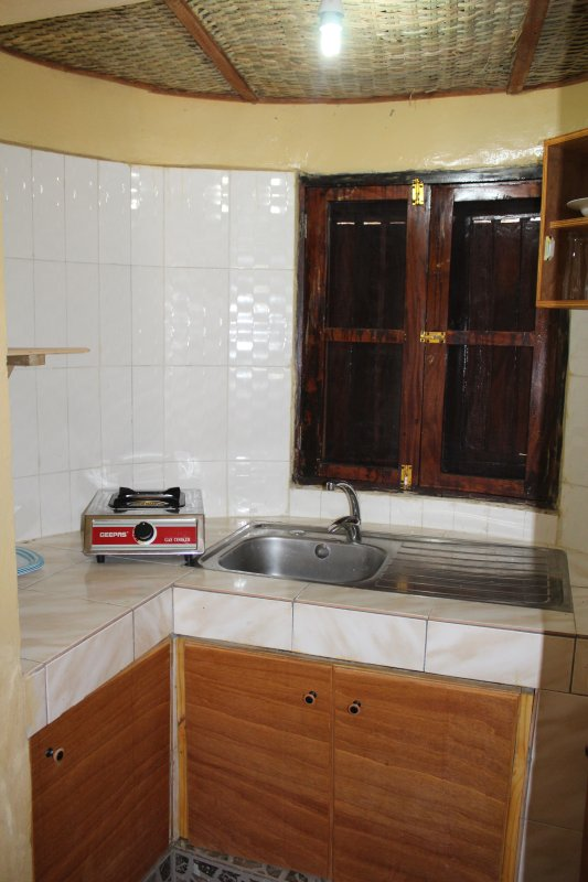 KITCHENETTE WITH WOVEN CEILING FEATURE