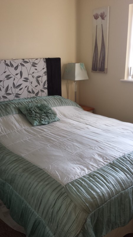 King size bed with views of riding school and entrane to campsite