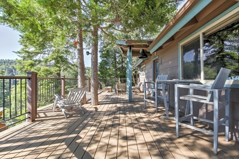 Enjoy spectacular mountain views from the expansive wrap-around deck at this great Running Springs vacation rental cabin.