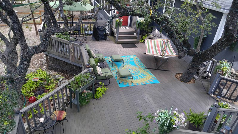 View of 2nd deck from the top deck with hammock, propane BBQ and patio furntiure