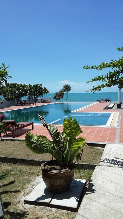 Beautiful pool with sandy white beach just steps from condo