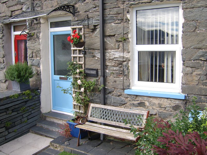 Front of cottage with garden bench