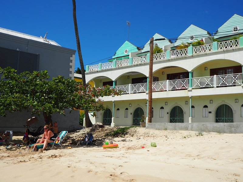 White Sands building from the beach. The upper left penthouse terrace belongs to Carib Edge
