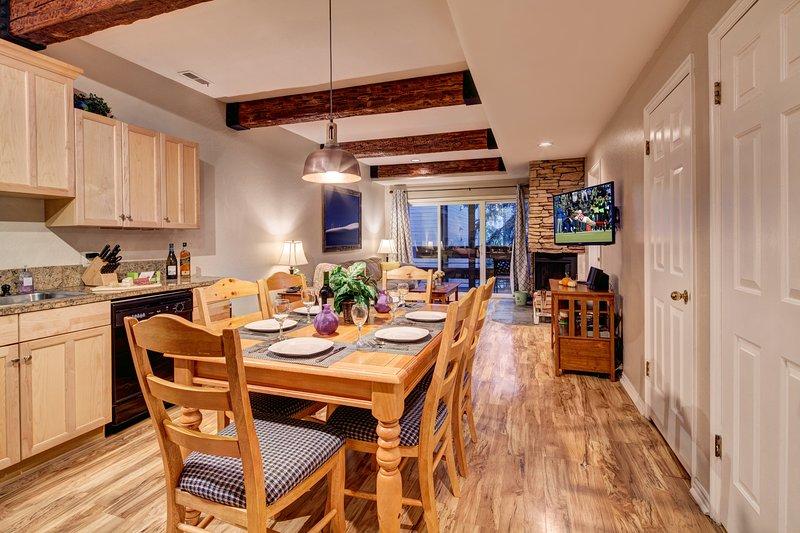 Open fully-equipped kitchen and dining room