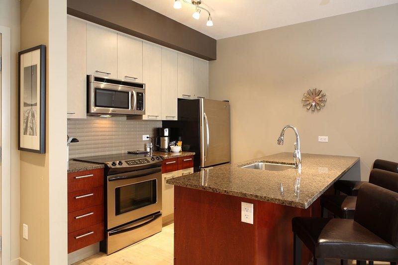 Cocine comidas con facilidad en la cocina totalmente equipada con excelentes electrodomésticos.