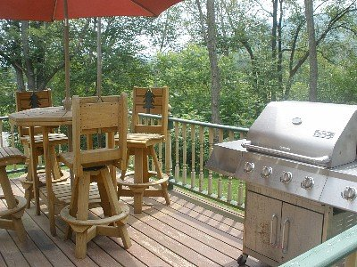 Front deck facing the ski slope w/ Adirondack table & chairs w/ large BBQ grill, hot tub off of deck
