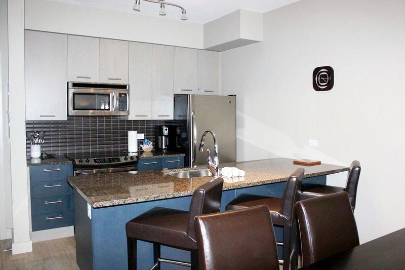 In der voll ausgestatteten Küche können Sie bequem Mahlzeiten zubereiten.
