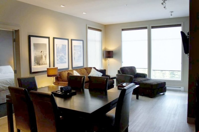 Relax in the living area and enjoy meals together at the dining table