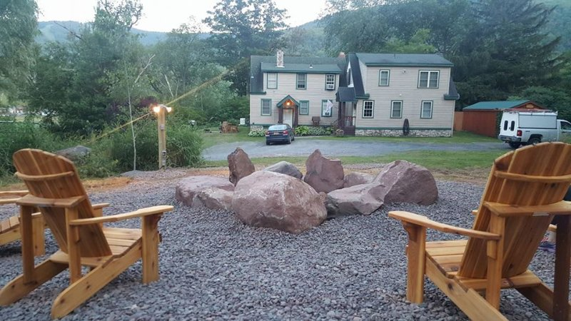 Fantastic outside fire-pit overlooking large home and the ski slope with plenty of parking.