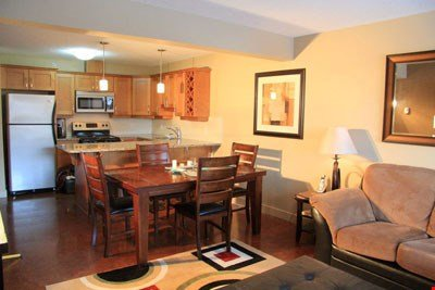 Enjoy meals together at the large wooden dining table and in the nice open concept living area.