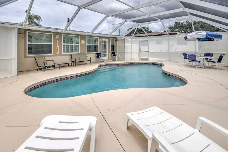 This 2BR, 2-bath vacation rental house in Englewood is your private paradise!