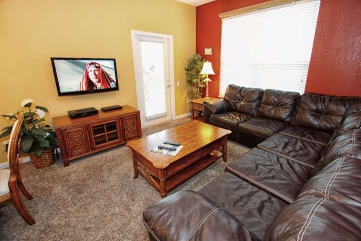Living Area with Leather Sectional, Flat Screen TV and Patio Access