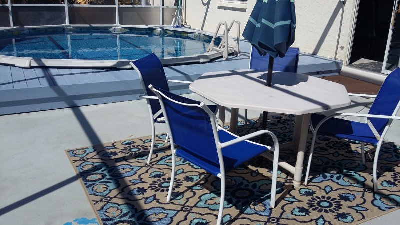 Completely enclosed pool and patio area with Outdoor Dining Table/Umbrella&Grill