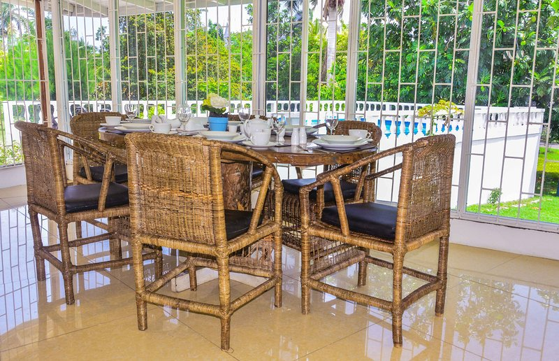 Second dinning area overlooking the swimming pool excellent views throughout the property