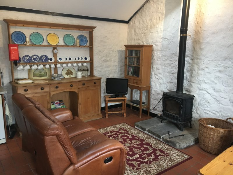 Starling cottage - living area with TV/DVD and woodburner