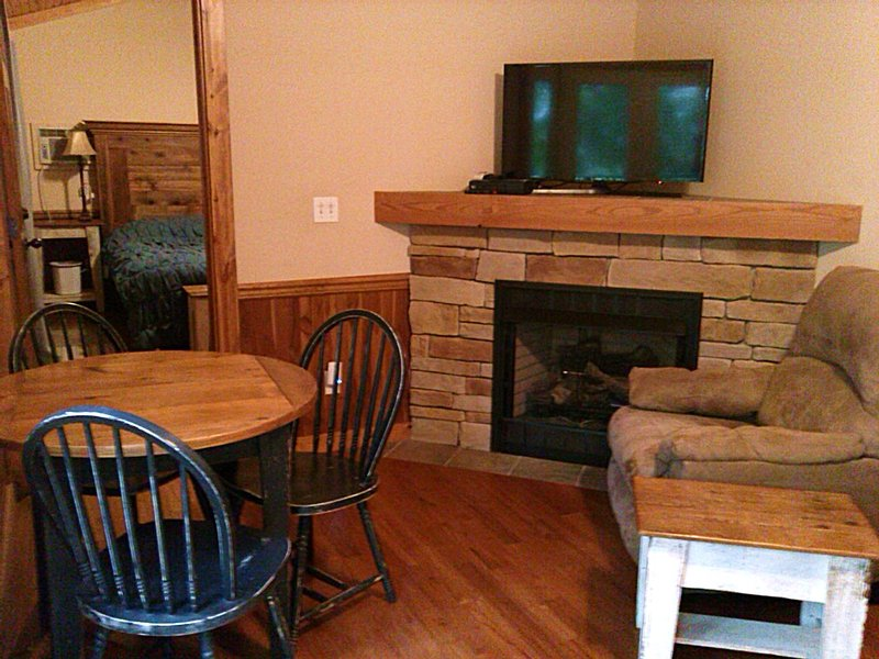 Gas-log fireplace in our one bedroom cabin rental, located in Elkins, WV.  Only 34 miles from Canaan
