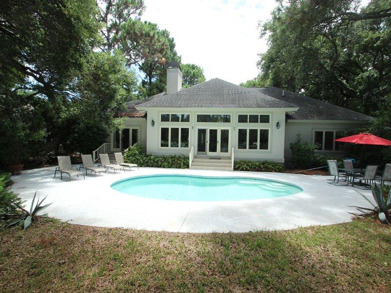 Lovely private back yard with pool & large patio