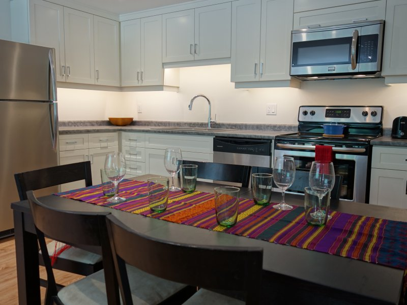 Everything you need in this fresh kitchen. Full stove & fridge. Coffee maker, dishes, pots, oil, etc