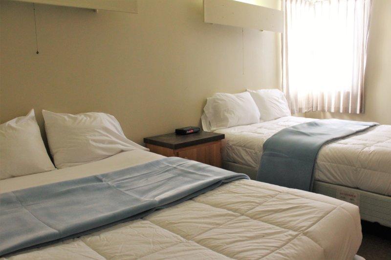 dos camas tamaño queen