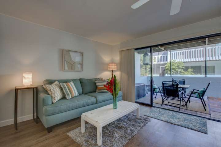Open the sliding doors out to your private screened balcony over looking the community pool.