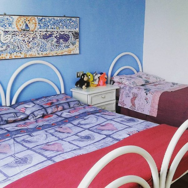 large bedroom with double bed and single, large window overlooking the garden and views ......