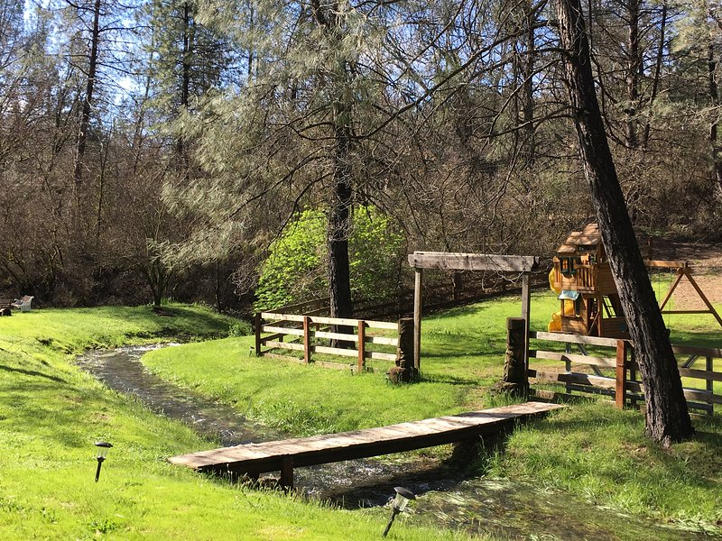 Walk across the bridge to the children's play area and more green space for picnicking or play yard games.