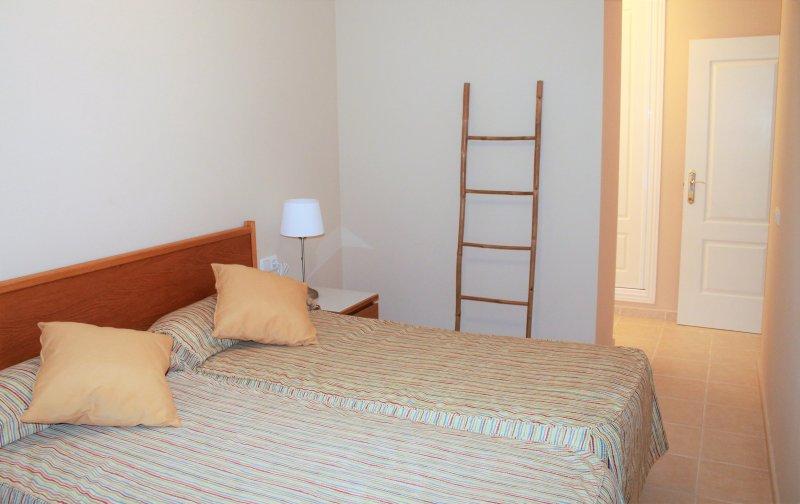Grande quarto com duas camas