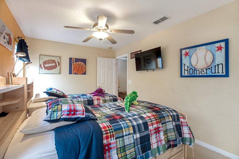 Twin beds, wardrobes, side table with flat screen TV. Access to Jack/Jill en-suite bathroom.