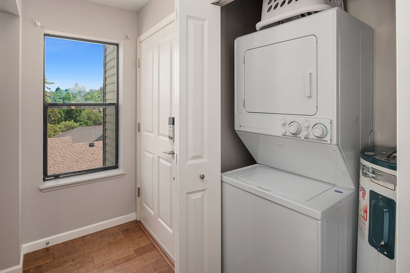The home is equipped with a full-size washer-dryer