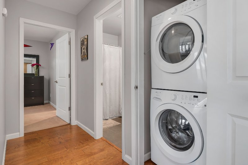 The unit is equipped with a full-size washer and dryer