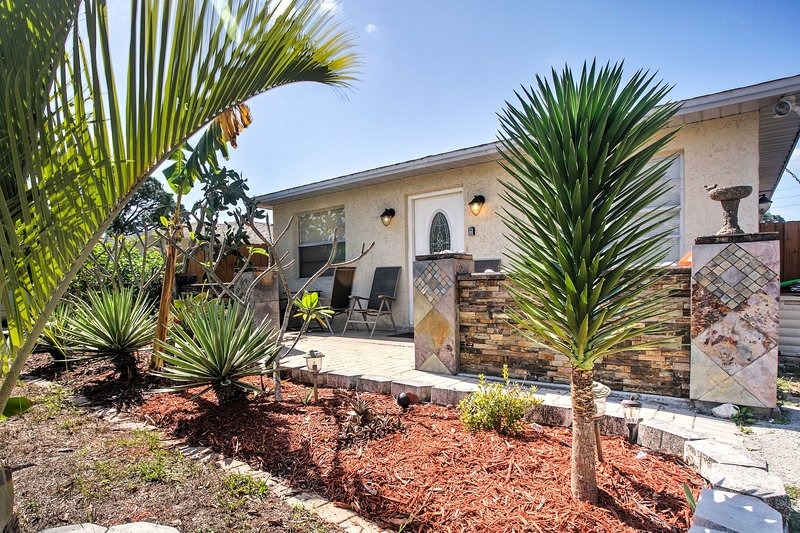 Welcome to your Naples home-away-from-home, with large yard!