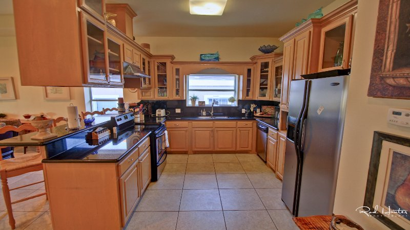 Kitchen has everything you needs to cook a meal.