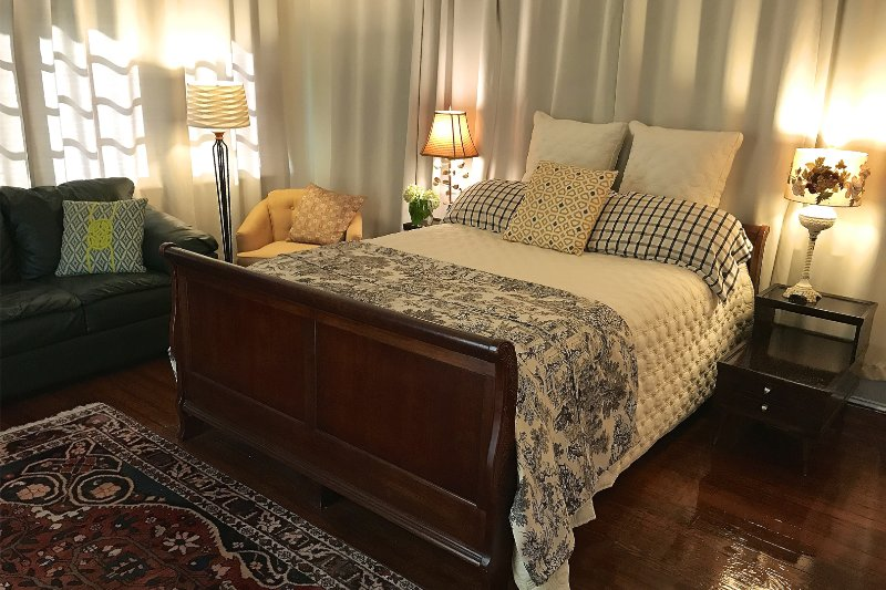 Treetop Room has a queen-size bed, sitting area and desk. Premium linens. Clock radio with usb ports