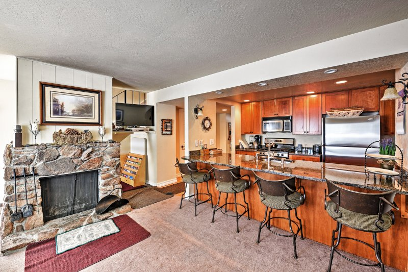 Warm up in front of the fireplace as you watch a show on the flat-screen TV.