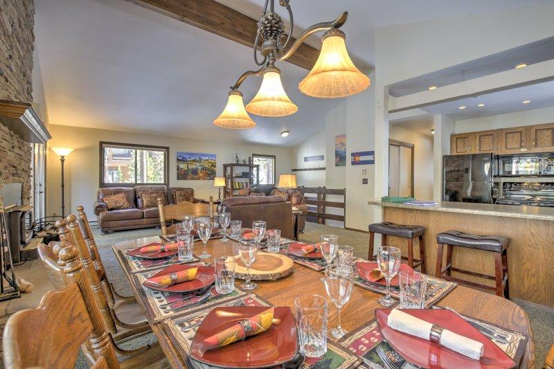 Gather around the stylish dining area to enjoy a culinary masterpiece.