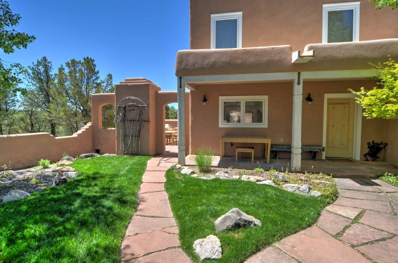 This custom 2,900-square-foot, 3-bedroom, 2.5-bathroom home transports you to Taos, New Mexico.