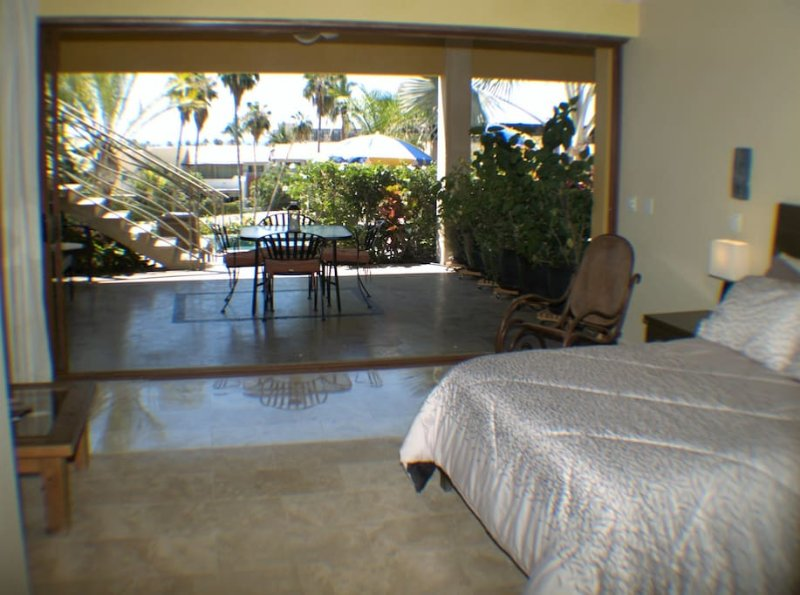 patio view  dinning area has bar fridge common area TV room with kitchenette  WiFi laundry room