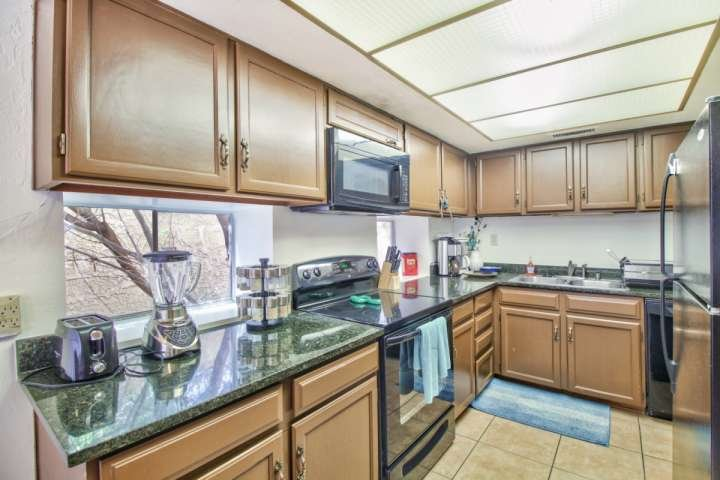 Furnished Kitchen with granite counter tops