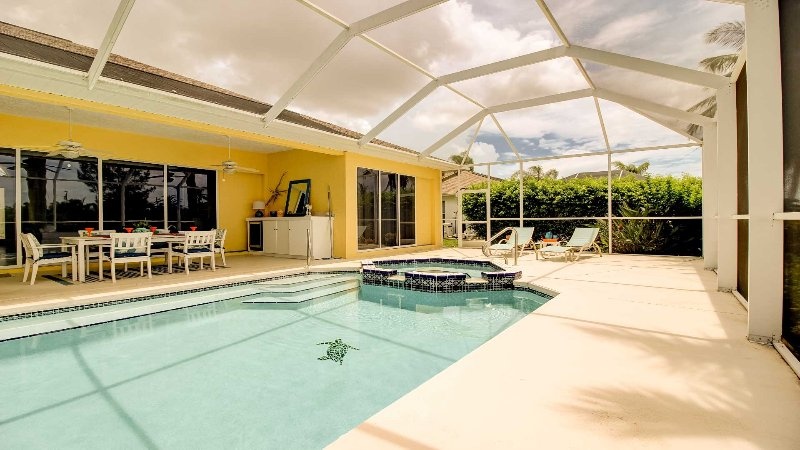 Screened in Pool Area has 'IT ALL'