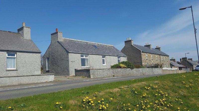Front of house overlooking Scapa Flow with views of the Italian Chapel and Churchill Barriers