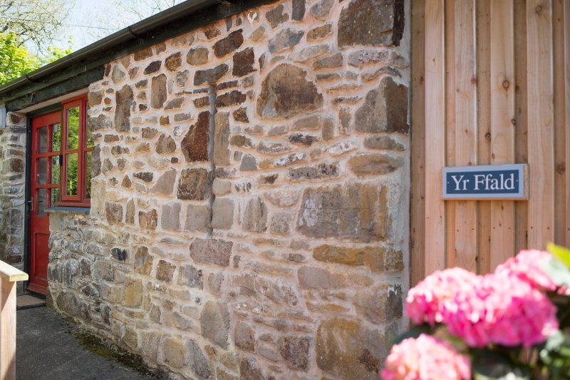 Yr Ffald Cottage. Ground floor accommodation with parking outside the cottage and ramp to the door.