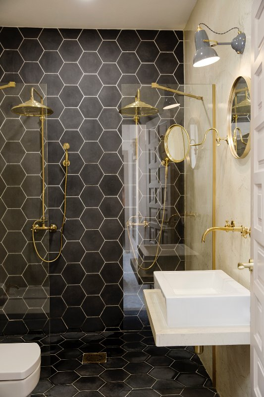 Double shower room. Two showers, toilet, bidet, basin.