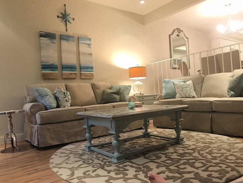 Beach cottage styled living room with comfortable sofas