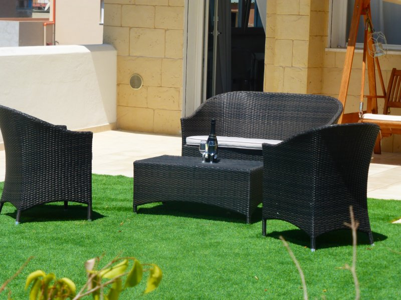 Relaxing lounge and rocking sofa on the lawn - The relaxation of the living room sofa and rocking on the lawn