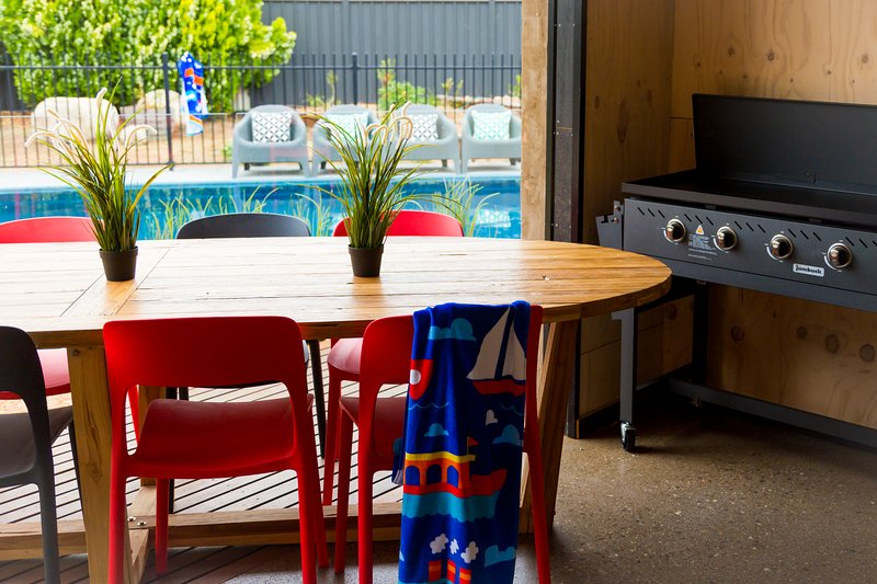 Outdoor undercover dining by the pool. Huuge BBQ to cook up a storm
