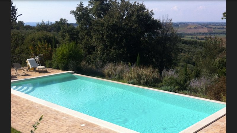 the salty swimming pool of the umbria villa with view on Tuscany and Umbria  the best in paciano are